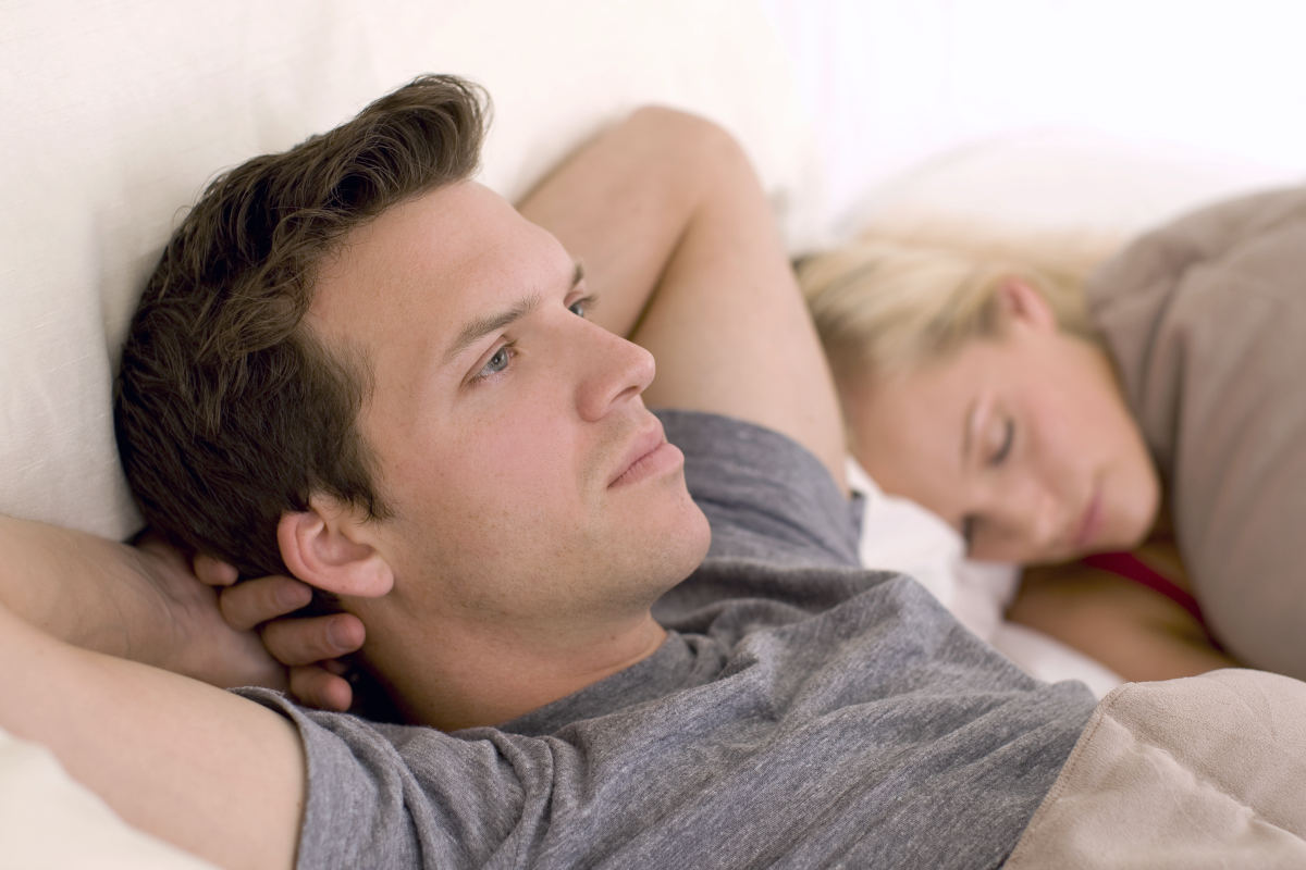 Couple in bed, man looking worried | What To Do When Viagra Doesn't Work | why viagra doesnt work