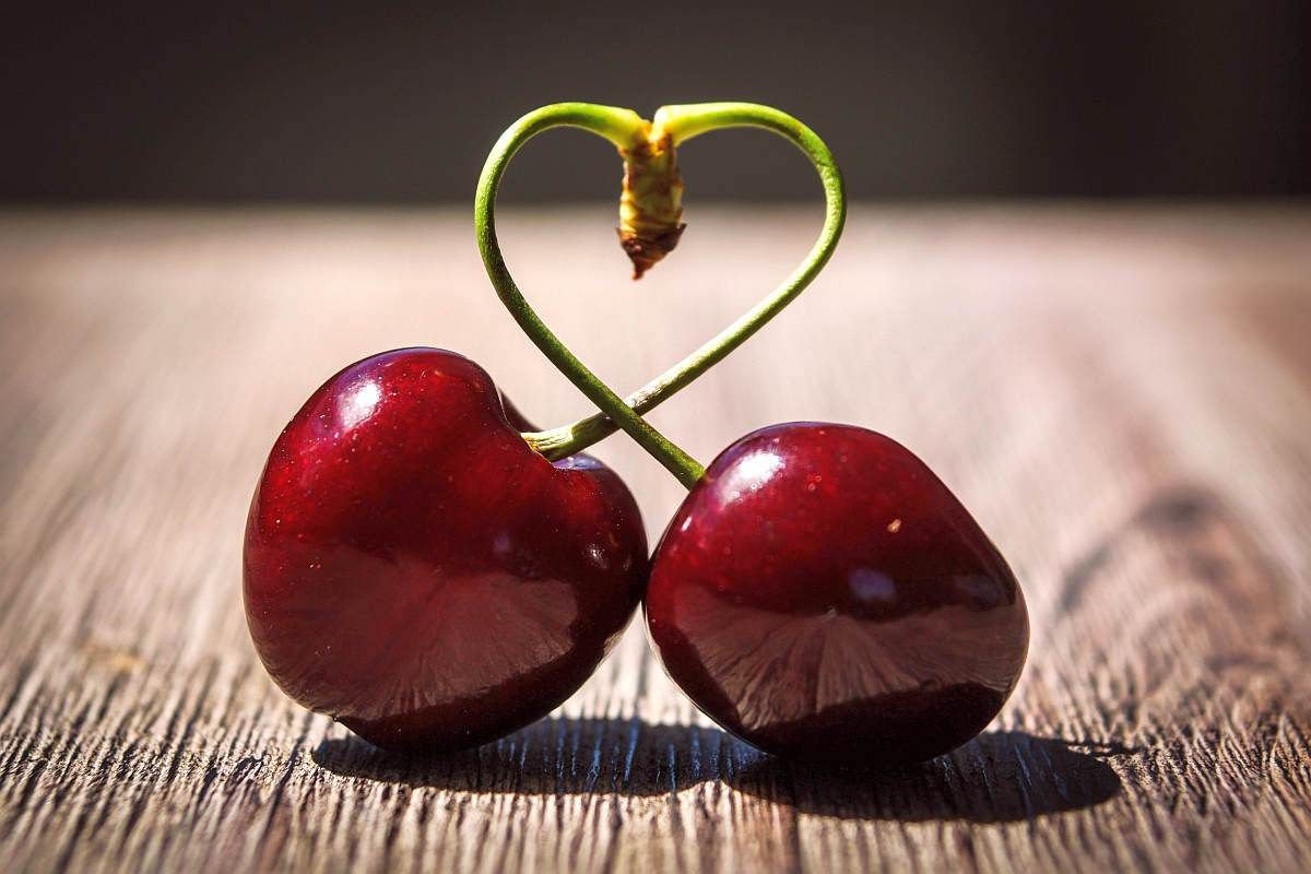 Two red cherries on brown surface  | Why It's So Hard To Talk About Bedroom Problems (And What We Can All Do To Change This) | How to Bring Up Lack of Intimacy