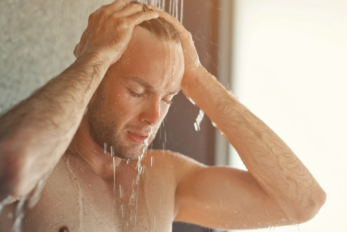 Handsome young man taking a shower   Tips & Tricks To Deal With Receding Hairline In Men   how to fix receding hairline